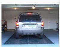 Put a MATS FOR SPLATS under your car to protect your garage floor